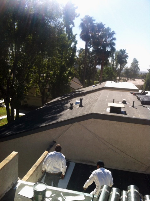 Contractors Repairing Apartment Roofing